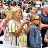 (Brad Davis/The Register-Herald) Family members angle for photos during Westside's commencement Saturday afternoon in Clear Fork.