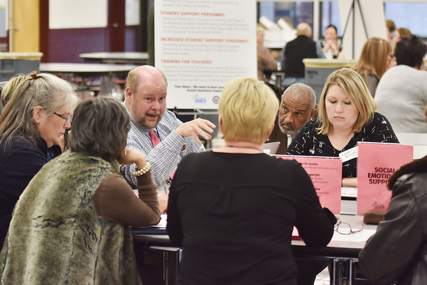 Woodrow Wilson High School teacher John Quesenberry, left, speaks to his table during a gathering by the West Virginia Department of Education with stakeholders on education at Woodrow Wilson High School in Beckley on Thursday. (Chris Jackson/The Register-Herald)