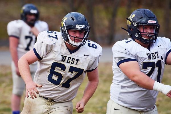 Greenbrier West's offensive lineman Tucker Gibson (67) and Hunter Starkey (71) during their football practice in Charmco on Tuesday. (Chris Jackson/The Register-Herald)