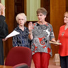 (Brad Davis/The Register-Herald) Zenda Vance, middle, is sworn in as Fayetteville Recorder during the town's Swearing In Ceremony Friday evening inside the Fayette County Courthouse.