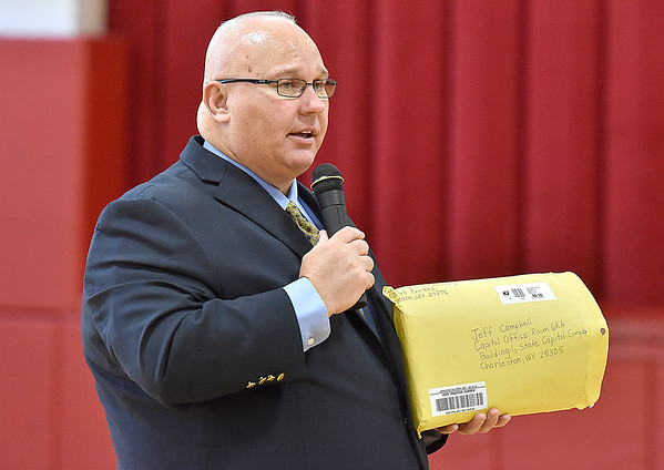 (Brad Davis/The Register-Herald) Holding the package full of cards he received from students at Berlin McKinney Elementary, Delegate Jeff Campbell (D-Greenbrier) personally thanks them during a visit to the school Wednesday afternoon in Oceana. Campbell's mother passed away during the last legislative session, and despite having few ties to the area except for being a teacher himself in Greenbrier County, every student at Berlin Mckinney wrote sympathy cards for him. He came back to thank them personally on Wednesday.