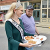 (Brad Davis/The Register-Herald) Lifetime Miss Becley-Raleigh County Riley Bowyer brings another round of food for judges as she's accompanied by dad Frank during the Appalachian Fest Block Party August 24 in Beckley.