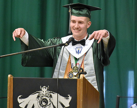 (Brad Davis/The Register-Herald) Wyoming East senior Dylan Repass speaks as the school's Salutatorian Friday night in New Richmond.