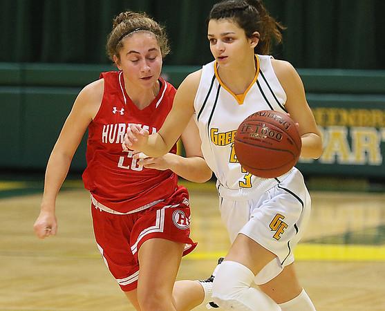 (Brad Davis/The Register-Herald) Greenbrier East's Amya Damon hustles up the court as Hurricane's Lauren Dye defends Saturday night in Fairlea.