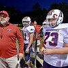 (Brad Davis/The Register-Herald) Head coach John Lilly, left, prepares to lead his Patriots onto the field for a road game at Summers County Friday night in Hinton.