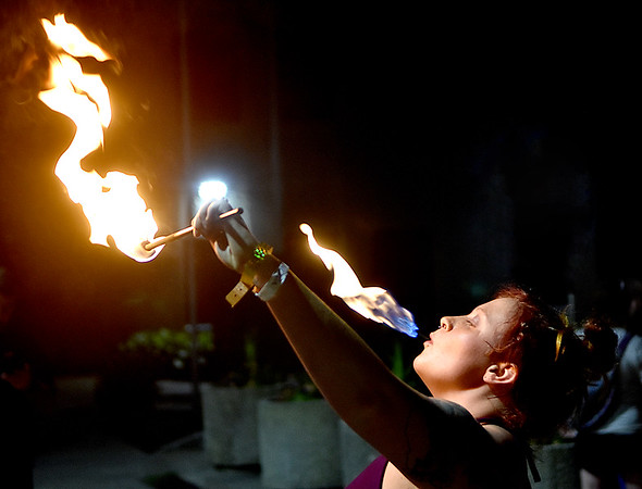 """(Brad Davis/The Register-Herald) Local artist, performer and fearless master of flames Tori Lilly lights up the night as she executes what's better known as """"fire eating"""" feats during an after-hours performace and demo in Beckley's Underground Saturday night, part of BEX activities in and around the city. The inaugural arts and entertainment festival wrapped up a successful week full of groundbreaking events Sunday."""