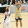 (Brad Davis/The Register-Herald) Shady Spring's Tommy Williams fires from three-point range as Woodrow Wilson's Maddex McMillion defends Saturday night at the Little General Battle for the Armory.