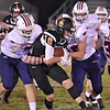 (Brad Davis/The Register-Herald) Summers County's Logan Fox is taken down by a gang of Patriots defenders after a good kick return  Friday night in Hinton.
