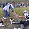 (Brad Davis/The Register-Herald) Managers get their Renegade teammates fired up as they help through warm-ups before the kickoff at in-county rival Wyoming East Friday night in New Richmond.