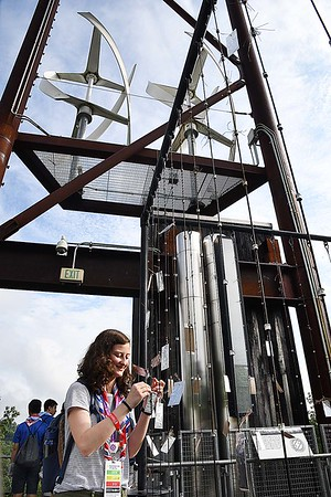 Caro Van Andel, of Netherlands, places a pledge on a cable on top of the Sustainability Treehouse, to live a more earth friendy life, during the World Scout Jamboree at the Summit Bechtel Reserve in Glen Jean.