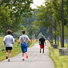 Runners on the Piney Creek Trail System at YMCA Paul Cline Memorial Youth Sports Complex.Each year on the first Wednesday in June, people across the United States participate in National Running Day.  This day was designated as a day for runners to reaffirm their passion for running. It is also a good day for beginners to begin a life-changing commitment to running.<br /> (Rick Barbero/The Register-Herald)