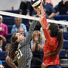 (Brad Davis/The Register-Herald) Westside's Shyan Jenkins leaps in to tap the ball over as Independence's Bella Acord defends during the Coalfield Conference Volleyball Tournament Saturday afternoon at Shady Spring High School.