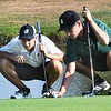 Tanner Walls, of Westside, left and Logan Miller, of Wyoming East, line up their putts on the par 4, second hole on Grandview Country Club during the Class AA Region 3 championships.<br /> (Rick Barbero/The Register-Herald)