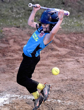 (Brad Davis/The Register-Herald) Beckley batter Hadley Reott earns herself a base by taking Hedgesville starter Chloe Frankhouser's pitch off her leg during Little League 8-10 year-old Softball State Tournament action Wednesday night at Affinity park in Midway.