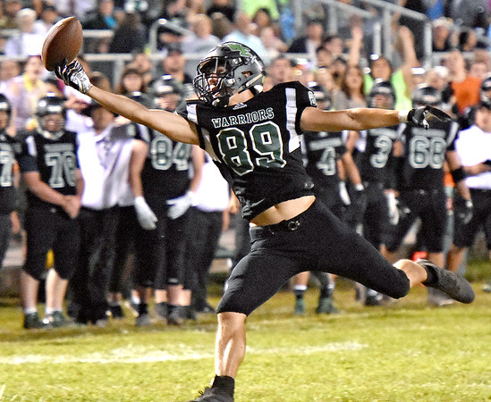 (Brad Davis/The Register-Herald) Wyoming East receiver Jacob Bishop nearly reaches an overthrown deep ball while wide open as it bounces off his fingertips Friday night in New Richmond.