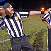 (Brad Davis/The Register-Herald) Ryan Haga, left, strikes a pose as the officiating crew for Indy and Summers gather on the field before dispersing to work the game Friday night in Hinton.