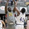 (Brad Davis/The Register-Herald) Oak Hill Academy's Kofi Cockburn drives to the basket as Crestwood Prep's Jo Smith defends during Big Atlantic Classic action Wednesday night at the Beckley-Raleigh County Convention Center