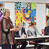 Esther Morey, the executive director of Coda Mountain Academy, speaks to the crowd and delegates and senators during a town hall meeting on education at Oak Hill High School in Oak Hill. (Chris Jackson/The Register-Herald)