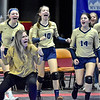 (Brad Davis/The Register-Herald) Greenbrier West assistant coach Emily Stacy, left, and players react with celebration from the bench after a Cavaliers run forced a timeout from opponent Paden City during State Volleyball Tournament action Friday afternoon at the Charleston Civic Center.