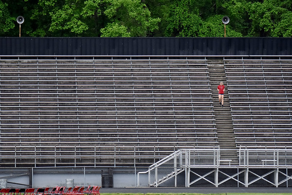 A runner goes down the stairs of the Oak Hill football stadium during the Oak Hill v Independence Class AA Region 3, Section 1 tournament game in Oak Hill on Thursday. (Chris Jackson/The Register-Herald)