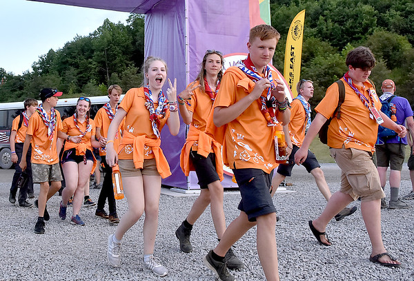 (Brad Davis/The Register-Herald) Dutch scouts notice the camera as they make their way to the stadium at the World Scout Jamboree's Cultural Celebration Friday night at the Bechtel Summit Reserve.