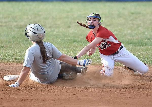 (Brad Davis/The Register-Herald) Independence shortstop Nicole Kester tags out Shady Spring baserunner Hadley Wood as she tries to reach 2nd base Thursday evening in Shady Spring.