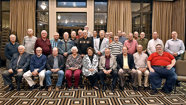 (Brad Davis/The Register-Herald) Attending current and former Beckley Police officers all gather for a group photo at the conclusion of the first Beckley police Alumni Association dinner and awards ceremony Saturday night at Black Knight Country Club.