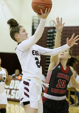 (Brad Davis/The Register-Herald) Woodrow Wilson's Liz Cadle drives to the basket as Cabell Midland's Emilie Charles defends Friday night in Beckley.
