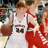 (Brad Davis/The Register-Herald) Woodrow Wilson's Ben Gilliam drives and scores as Parkersburg's Jacob McKnight defends Friday night at the Beckley-Raleigh County Convention Center.