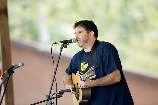Delegate Mike Pushkin, (D-Kanawha), performs a song during the annual UMWA Labor Day Celebration at John Slack Memorial Park in Racine on Monday. (Chris Jackson/The Register-Herald)