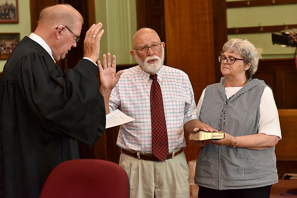 (Brad Davis/The Register-Herald) Stanley Boyd is sworn in as Fayetteville Councilperson during the town's Swearing In Ceremony Friday evening inside the Fayette County Courthouse.