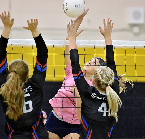 (Brad Davis/The Register-Herald) Nicholas County's Rachel LeRose spikes the ball as Westside's Lauren thomas, left, and Lathea Hatfield defend during the Coalfield Conference Volleyball Tournament Saturday afternoon at Shady Spring High School.