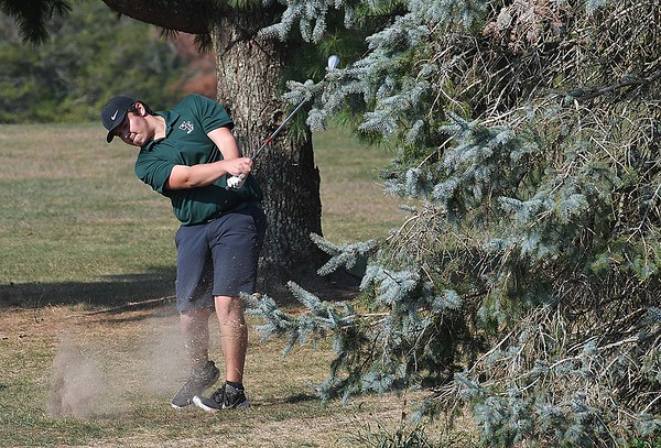 Ethan Bradford, of Wyoming East, hits his second shot on the par 4, 5th hole during the Class AA Region 3 championships held on Grandview Country Club.<br /> (Rick Barbero/The Register-Herald)