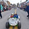 (Brad Davis/The Register-Herald) Young participants Brack McClung (right), 5, and little brother Zeke, 3, pilot their New Year's themed power wheel along as hundreds attend during Lewisburg's annual Shanghai Parade Wednesday afternoon.