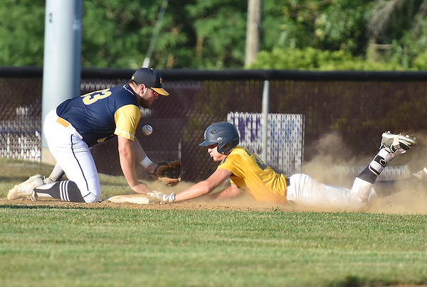 (Brad Davis/The Register-Herald) Beckley Post 32's Logan Stump slides safe into 3rd on a triple as the ball gets in late to Summersville Post 131 infielder Jak Kuhl Thursday evening at Woodrow Wilson High School.