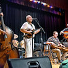 (Brad Davis/The Register-Herald) From left, Barbara Rosner, Lewis Prichard, Hunter Walker and Brian Bell jam appalachian style as Beckley's own Long Point String Band performs the opening set of a night of string music during the Beckley Concert Association's Appalachian Jamboree Thursday night inside the Woodrow Wilson High School Auditorium. Long Point opened the night, the first of six scheduled events this season for BCA, followed by two other performances from Charleston-based Blue Yonder and headliner Mike Mitchell.