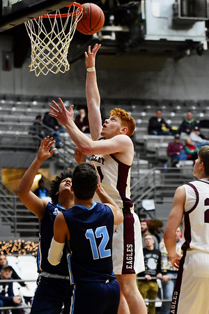 Woodrow Wilson's Ben Gilliam (24) puts up a shot over Spring Valley's Tauvea Davis (12) and Corbin Page (40) during the first half of their basketball game in Beckley on Tuesday. (Chris Jackson/The Register-Herald)