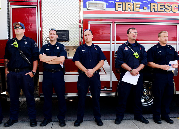 Members of the Beckley Fire Department look on as the annual 9/11 ceremony at the 9/11 Memorial at Word Park in Beckley on Wednesday. (Chris Jackson/The Register-Herald)