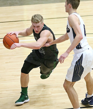 (Brad Davis/The Register-Herald) Wyoming East's McQuade Canada drives along the baseline as Shady Spring's Tommy Williams defends on Big Atlantic Classic Championship Saturday at the Beckley-Raleigh County Convention Center.