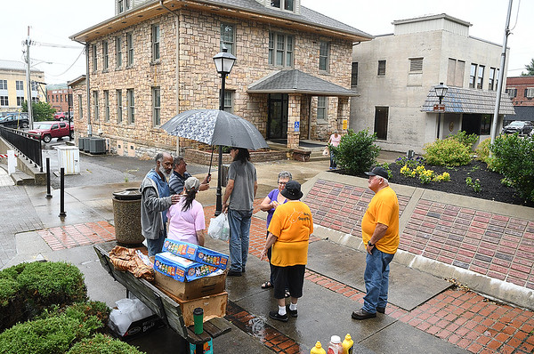 Calvary Assembly of God church members handed out free lunches to homeless people at Shoemaker Square in Beckley Tuesday afternoon. They set up every third and fifth tuesday from 11 am to 1 p.m. during the month and serve, hotdogs, sandwiches, chips, fruit snacks and water.<br /> (Rick Barbero/The Register-Herald)