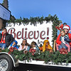 (Brad Davis/The Register-Herald) Participants riding on the Beckley First Baptist Church float wave and toss candy to the masses during the Beckley Christmas Parade Saturday morning.