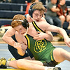 (Brad Davis/The Register-Herald) Greenbrier East's Alex Zimmerman takes on Richlands' Jacob Puckett in a 152-pound weight class matchup during the Appalachian Fasteners Invitiational Saturday afternoon in Shady Spring. Richlands' Puckett won the match.