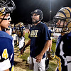 (Brad Davis/The Register-Herald) Shady Spring coach Vince Culicerto, middle, and players Isaiah Valentine, left, and Drew Clark, right, talk about the game plan prior to the start of the second half of their game against Lincoln County Fridya night in Shady Spring.