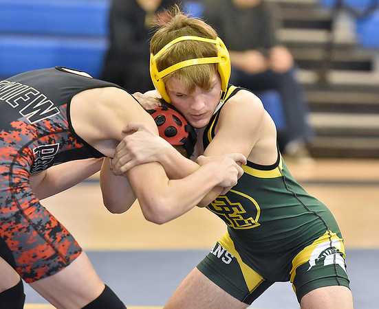 (Brad Davis/The Register-Herald) Greenbrier East's Chase Browning takes on PikeView's Logan Hylton in a 120-pound weight class matchup during the Appalachian Fasteners Invitiational Saturday afternoon in Shady Spring. Greenbrier East's Browning pinned Hylton to win the match.