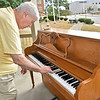 (Brad Davis/The Register-Herald) Mark McGraw taps the broken keys of the piano placed under the Jim Word Memorial Park gazebo last year after it was discovered to be battered and rendered useless by vandals over the weekend. Originally gifted to 110 Marshall owner Rebecca Beckett by the late Mike Richmond, the piano was then donated to the City of Beckley. Officials decided to place it under the Word Park gazebo as a way to foster public arts and tap into the growing culture of cities placing instruments in public spaces to encourage street music. City officials said they'll replace the piano through donation.