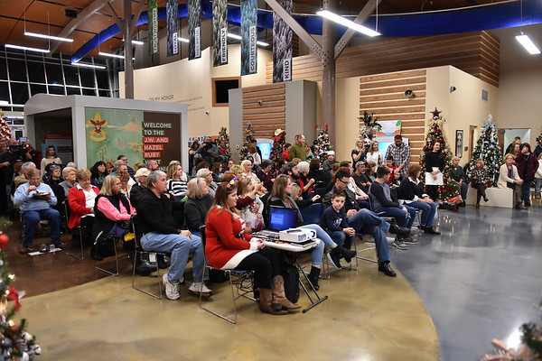 People await the auction during the 11th annual United Way of Southern West Virginia's Wonderland of Trees Auction at the J.W. And Hazel Ruby West Virginia Welcome Center in Mt. Hope on Friday. (Chris Jackson/The Register-Herald)