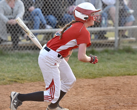 (Brad Davis/The Register-Herald) Independence hitter Nicole Kester watches her shot fly to the right centerfield gap for an RBI-double off Shady Spring pitcher Brooke Presley, part of a late-inning rally by the Patriots Thursday evening in Shady Spring.
