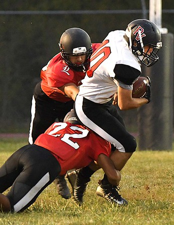Liberty's defense bring down, Ethan Begovich, of Pikeview at Liberty High School in Glen Daniels.<br /> (Rick Barbero/The Register-Herald)