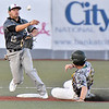 (Brad Davis/The Register-Herald) Miners baserunner Will Harless is forced out at 2nd by Danville shortstop Santino Rivera, while batter Kyle Schaefer would beat the throw to 1st to prevent a potential double play from being completed Saturday night at Linda K. Epling Stadium.