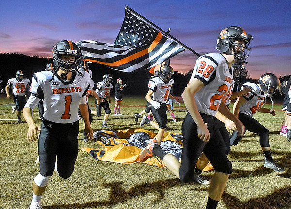 (Brad Davis/The Register-Herald) The visiting Summers County Bobcats charge onto the field to try and spoil Liberty's homecoming Friday night in Glen Daniel.